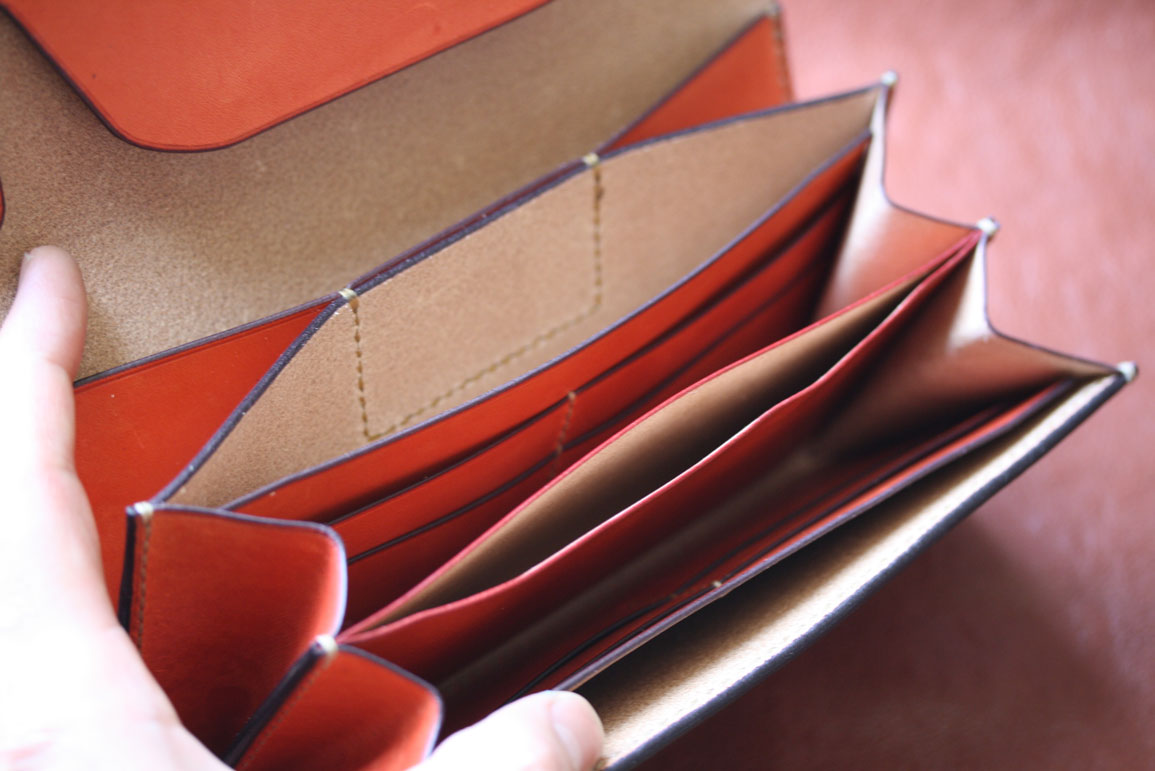 オレンジ革ホック財布